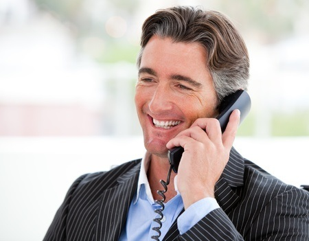 10131740 - portrait of a smiling businessman on phone